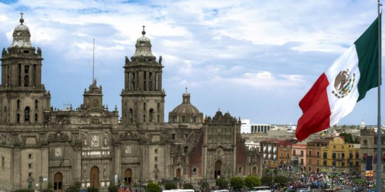 Move and relocate to Mexico City CDMX and visit the Cathedral at the Zocalo and see the giant Mexican Flag